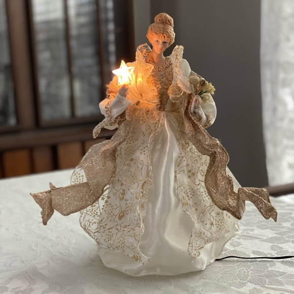 Animated and light up ceramic angel tree topper